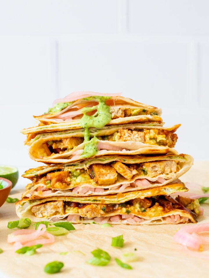 This Vegan BBQ Chicken Folded Wrap is inspired by the tiktok trend! A toasty wrap with avocado, pickled onions, a creamy sauce & vegan chicken. All in a compact tortilla you can take on the go   ThisSavoryVegan.com #thissavoryvegan #tiktokwrap #veganwrapideas