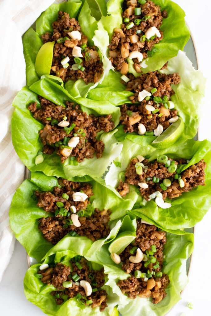 These Vegan Beef Lettuce Wraps are the perfect light meal. Loaded with vegan beef crumbles, a hoisin sauce and crunchy water chestnuts | ThisSavoryVegan.com #thissavoryvegan #veganappetizer #lettucewraps