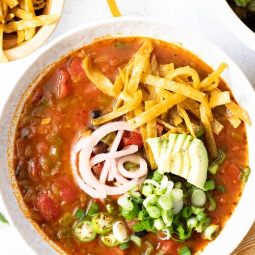 This Simple Vegan Tortilla Soup is veggie packed and loaded with flavor. Ready in 30 minutes and perfect for meal prepping   ThisSavoryVegan.com #thissavoryvegan #vegansoup #veganmealprep