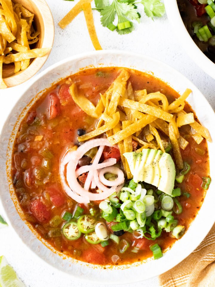 This Simple Vegan Tortilla Soup is veggie packed and loaded with flavor. Ready in 30 minutes and perfect for meal prepping | ThisSavoryVegan.com #thissavoryvegan #vegansoup #veganmealprep