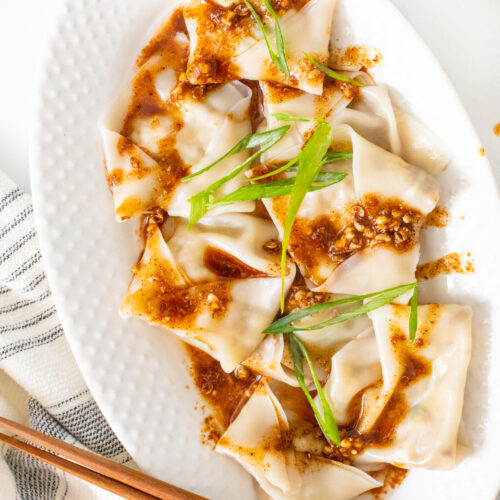 These Mushroom & Cabbage Dumplings are easy to make and beyond delicious. Served up with the best spicy Sichuan peppercorns sauce   ThisSavoryVegan.com #thissavoryvegan #vegandumplings #mushroomdumplings