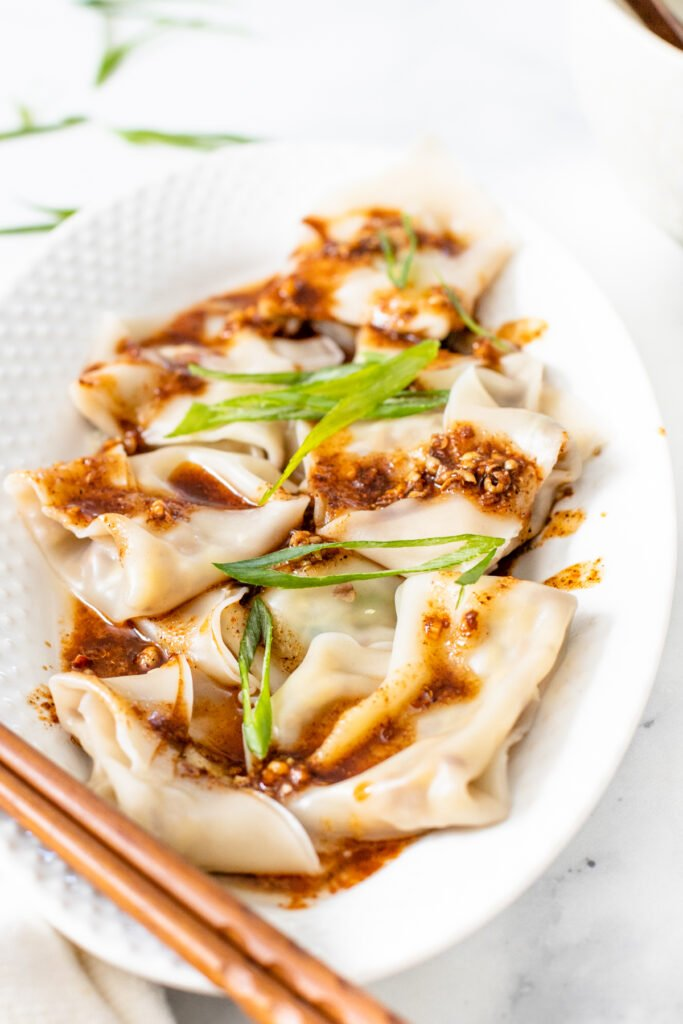 These Mushroom & Cabbage Dumplings are easy to make and beyond delicious. Served up with the best spicy Sichuan peppercorn sauce | ThisSavoryVegan.com #thissavoryvegan #vegandumplings #mushroomdumplings
