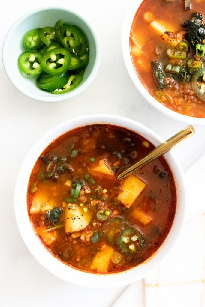 This Zesty Potato, Kale & Lentil Soup has the perfect smoky flavor and is loaded with protein, veggies & carbs. A complete vegan dinner made simple | ThisSavoryVegan.com #thissavoryvegan #vegansoup #potatosoup
