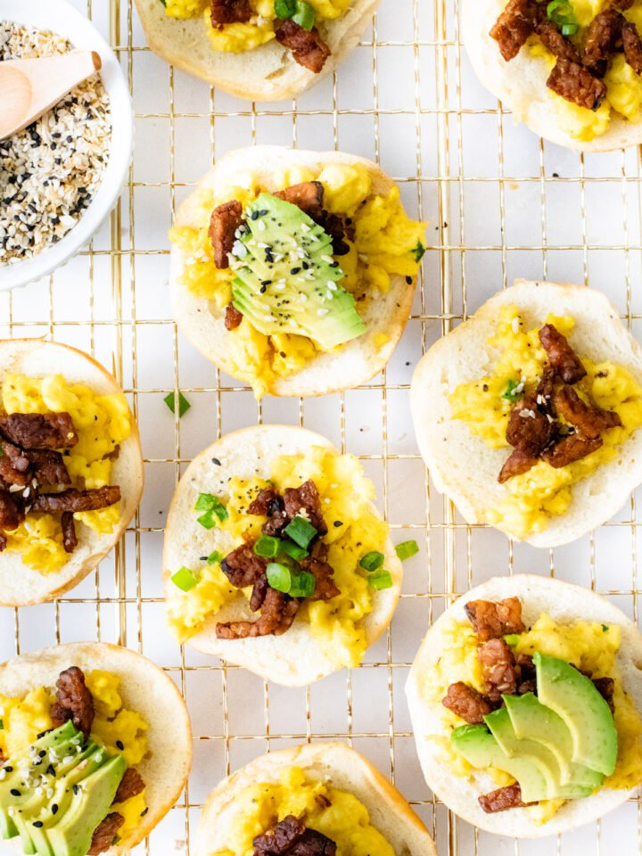 These Vegan Breakfast Bagel Bites are a super fun weekend breakfast - mini bagels loaded with vegan eggs, tempeh bacon & all the toppings | ThisSavoryVegan.com #thissavoryvegan #veganbrunch #veganbreakfast