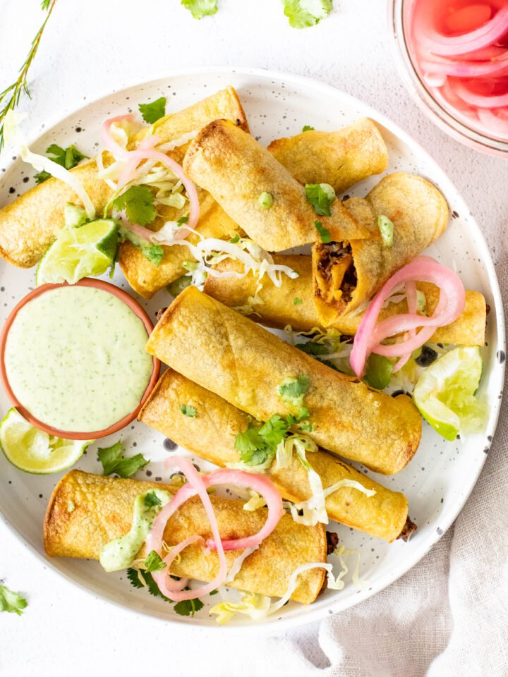 These Vegan Chipotle Lentil Rolled Tacos are spicy, crispy and served with vegan jalapeño ranch! Baking and air fryer instructions are included | ThisSavoryVegan.com #thissavoryvegan #rolledtacos #flautas
