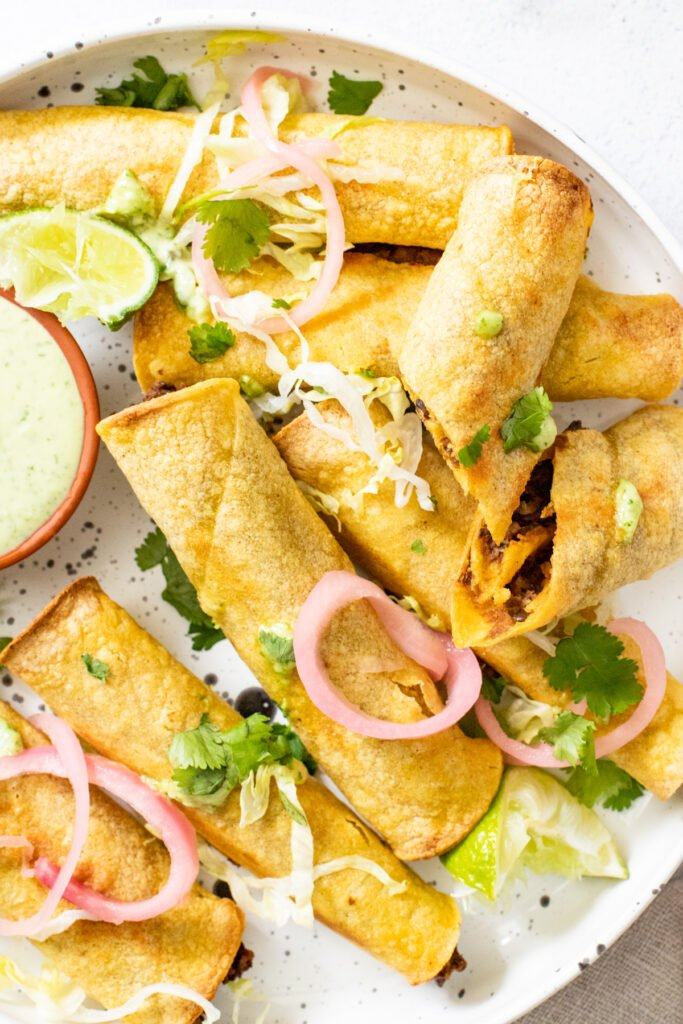 These Vegan Chipotle Lentil Rolled Tacos are spicy, crispy and served with vegan jalapeño ranch! Baking and air fryer instructions are included   ThisSavoryVegan.com #thissavoryvegan #rolledtacos #flautas