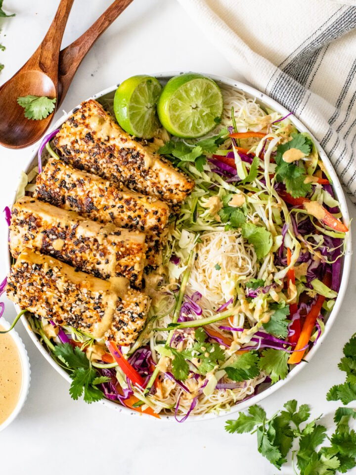 This Peanut Noodle Salad with Sesame Tofu is a combo of crunchy raw veggies, vermicelli rice noodles, crispy sesame tofu and spicy peanut sauce | ThisSavoryVegan.com #thissavoryvegan #peanutnoodles #coldsalads