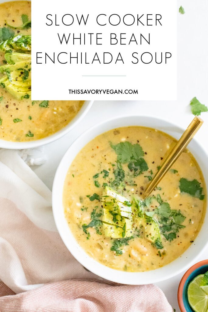 Quick, easy and delicious this Slow Cooker White Bean Enchilada Soup is the perfect vegan weeknight dinner! Stove top instructions included as well | ThisSavoryVegan.com #thissavoryvegan #slowcookerrecipe #vegansoup