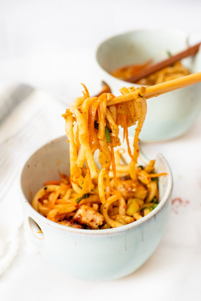 These Udon Noodles with Black Pepper Tofu are filled with crispy veggies, savory noodles and fried tofu. The perfect vegan noodle bowl   ThisSavoryVegan.com #thissavoryvegan #noodlebowls #tofurecipes