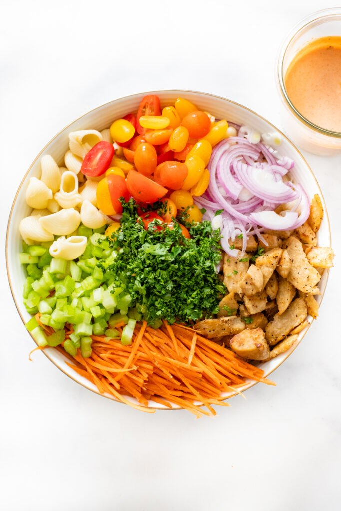 This Vegan Buffalo Chicken Pasta Salad is the perfect cold side dish. Crunchy veggies, charred vegan chicken and a zesty buffalo dressing   ThisSavoryVegan.com #thissavoryvegan #veganpastasalad #vegansidedish