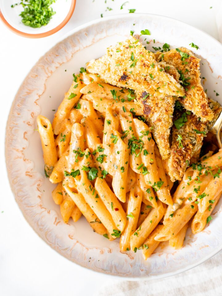 This Vegan Cajun Pasta with Panko Tempeh is comfort in a bowl. Creamy pasta, crunchy tempeh and the perfect amount of spice - a must make | ThisSavoryVegan.com #thissavoryvegan #veganpasta #tempeh