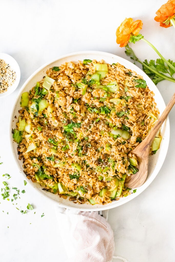This Vegan Sesame Ginger Fried Rice is packed with flavor and bulked up with mushrooms and bok choy. A quick snack or side dish   ThisSavoryVegan.com #thissavoryvegan #friedrice #vegansides