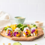 These Sesame Tofu Summer Rolls are filled with bright veggies and served with the best peanut dipping sauce! A great lunch or snack | ThisSavoryVegan.com #thissavoryvegan #summerrolls #vegansnack