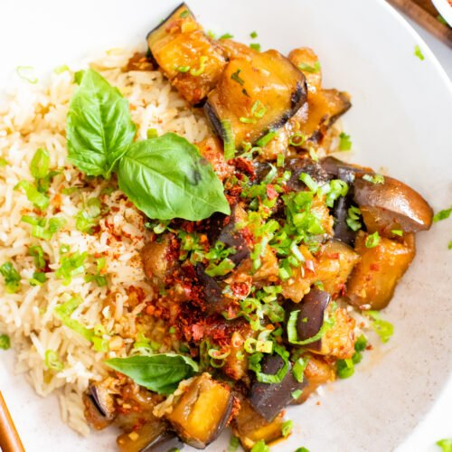 This Sweet and Spicy Braised Eggplant is tender and saucy. Adjust the spice to your taste and serve over coconut rice for a tasty dinner | ThisSavoryVegan.com #thissavoryvegan #eggplantrecipes #vegandinner