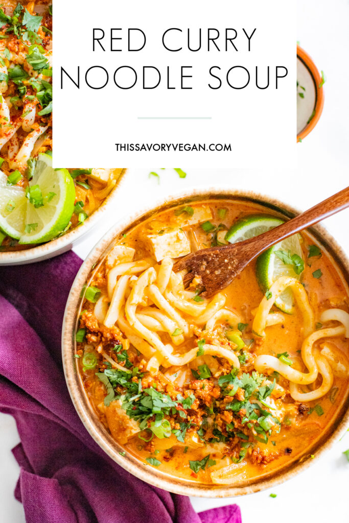 This Red Curry Noodle Soup is perfectly creamy, loaded with udon noodles & tofu and topped off with crispy cauliflower rice for some crunch | ThisSavoryVegan.com #thissavoryvegan #vegansoup #thairecipes