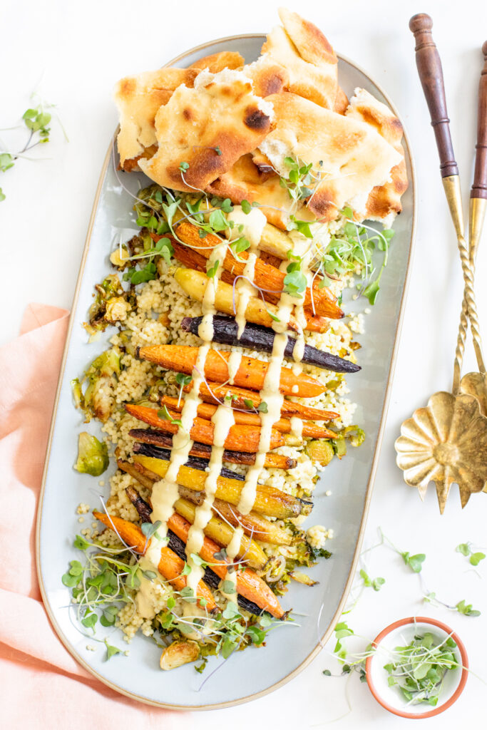 This Roasted Carrots, Brussels Sprouts & Acini Salad is the perfect lunch. Served with a mustard tahini sauce and toasted naan | ThisSavoryVegan.com #thissavoryvegan #roastedveggies #pastasalad