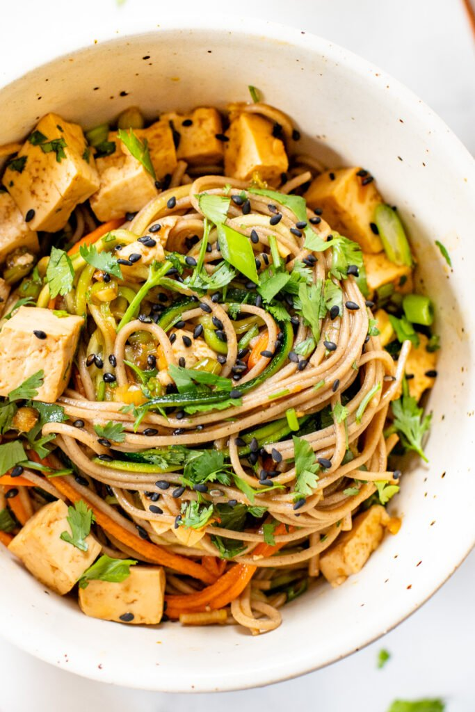 This Sesame Soba & Zoodle Salad is filled with healthy veggies, a savory sauce and flavorful tofu. A quick vegan lunch or dinner | ThisSavoryVegan.com #thissavoryvegan #sobasalad #zucchininoodles