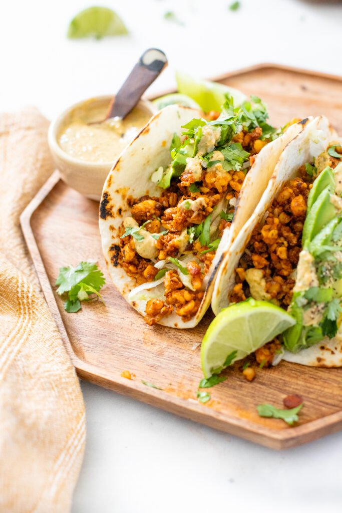 These Tempeh Soyrizo Vegan Tacos have a crispy tempeh filling, refried beans and a habanero cream sauce that adds so much flavor   ThisSavoryVegan.com #thissavoryvegan #vegantacos #tempehrecipes