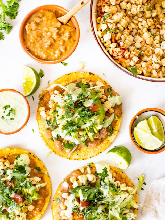 These Vegan Grilled Corn Tostadas are loaded with refried beans, charred corn and a creamy habanero sauce | ThisSavoryVegan.com #thissavoryvegan #vegandinnerideas #vegantostadas