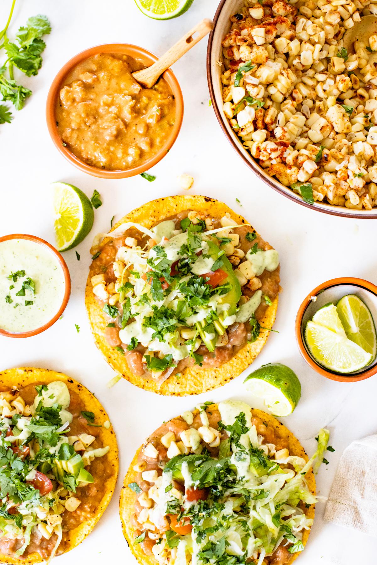 These Vegan Grilled Corn Tostadas are loaded with refried beans, charred corn and a creamy habanero sauce   ThisSavoryVegan.com #thissavoryvegan #vegandinnerideas #vegantostadas