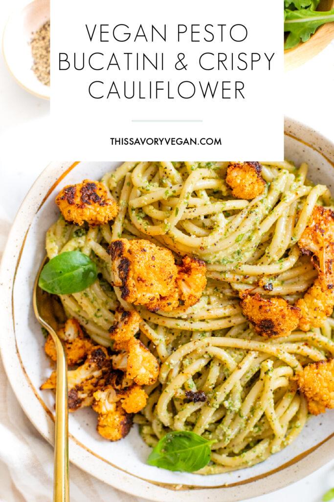 This Vegan Pesto Bucatini with Crispy Cauliflower is a quick and easy vegan dinner! Homemade argula-basil pesto & seasoned baked cauliflower over a bed of pasta   ThisSavoryVegan.com #thissavoryvegan #veganpesto #veganpasta