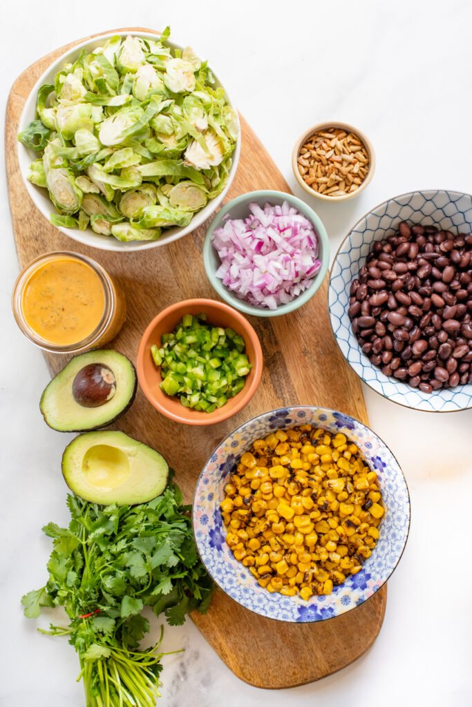 This Brussels Sprouts Corn Salad is served up with vegan chipotle ranch and is ready in just 30 minutes! A simple vegan salad that can be prepped ahead of time | ThisSavoryVegan.com #thissavoryvegan #chipotledressing #summersalad