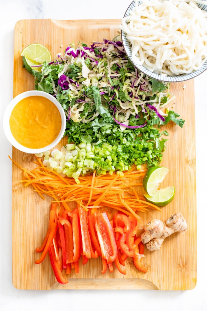 This Red Curry Udon Noodle Salad is made with a spicy tahini red curry sauce, crunchy veggies and cold udon noodles | ThisSavoryVegan.com #thissavoryvegan #tahininoodlesalad #reducurrysauce