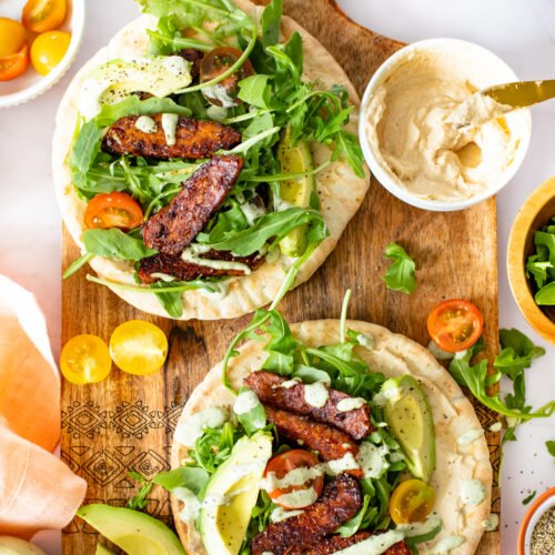 These Tempeh Caesar Salad Pitas are made with the BEST vegan caesar dressing, crispy tempeh and plenty of fresh veggies. Seriously addicting and a great vegan lunch idea   ThisSavoryVegan.com #thissavoryvegan #vegancaesarsalad #veganlunchideas