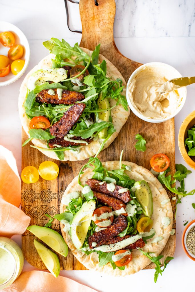 These Tempeh Caesar Salad Pitas are made with the BEST vegan caesar dressing, crispy tempeh and plenty of fresh veggies. Seriously addicting and a great vegan lunch idea | ThisSavoryVegan.com #thissavoryvegan #vegancaesarsalad #veganlunchideas