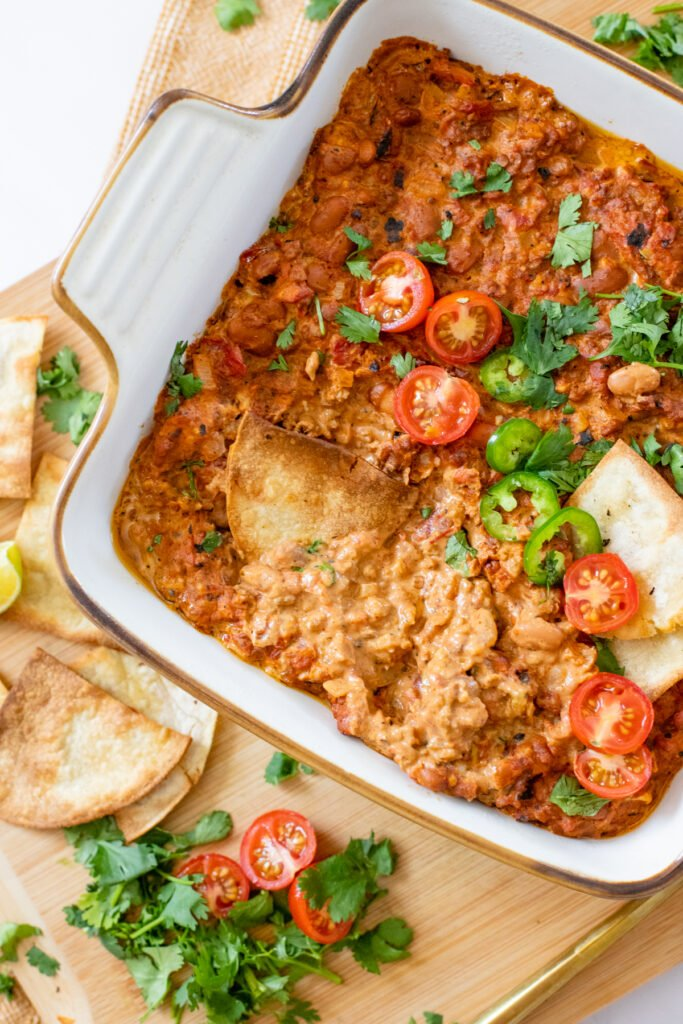 This Creamy Vegan Taco Dip is the perfect party appetizer. Serve with crispy chips or add to a taco bowl for a quick weeknight dinner   ThisSavoryVegan.com #thissavoryvegan #vegandips #veganappetizers