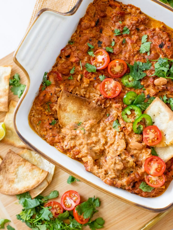 This Creamy Vegan Taco Dip is the perfect party appetizer. Serve with crispy chips or add to a taco bowl for a quick weeknight dinner | ThisSavoryVegan.com #thissavoryvegan #vegandips #veganappetizers