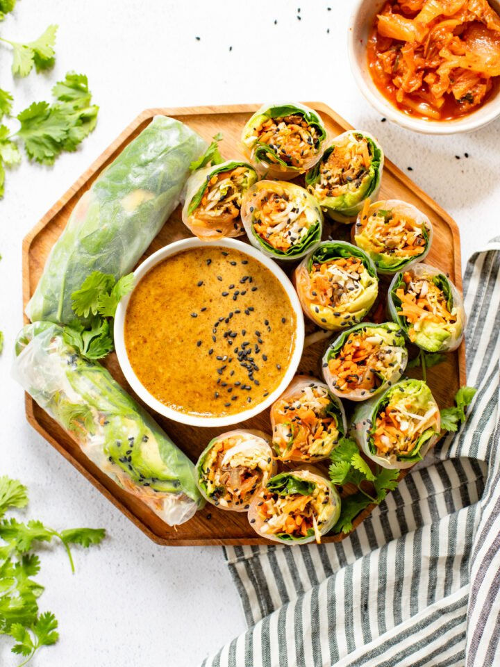 These Kimchi Summer Rolls with Almond Dipping Sauce are filled with fresh veggies, cooked mushrooms and tangy Nasoya kimchi | ThisSavoryVegan.com #thissavoryvegan #kimchi #summerrollrecipes