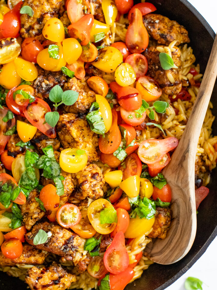 If summer were a dish it would be this Greek Tempeh Orzo Skillet! Fresh tomatoes, basil, orzo, tempeh - cooked in one skillet and totally tasty | ThisSavoryVegan.com #thissavoryvegan #skilletdinner #summervegandinner