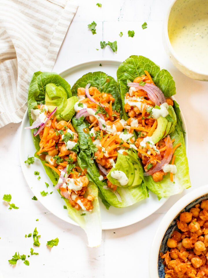 Loaded with avocado, red onion, carrots & vegan ranch - these Buffalo Chickpea Lettuce Wraps are a super easy vegan lunch | ThisSavoryVegan.com #thissavoryvegan #veganlunchideas #lettucewraps