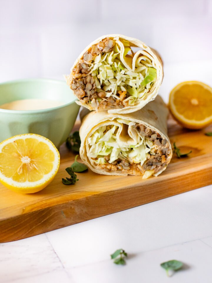 These Spicy Lentil & Rice Wraps are seasoned to perfection, loaded with crunchy cabbage and served with a tangy lemon tahini sauce | ThisSavoryVegan.com #thissavoryvegan #veganwraps #traderjoescopycatrecipe