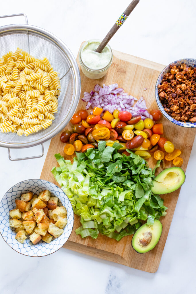This Vegan Bacon Ranch Pasta Salad is loaded with tofu bacon, romaine, cherry tomatoes, homemade croutons, avocado, red onion and creamy vegan ranch   ThisSavoryVegan.com #thissavoryvegan #veganpastasalad #tofubacon