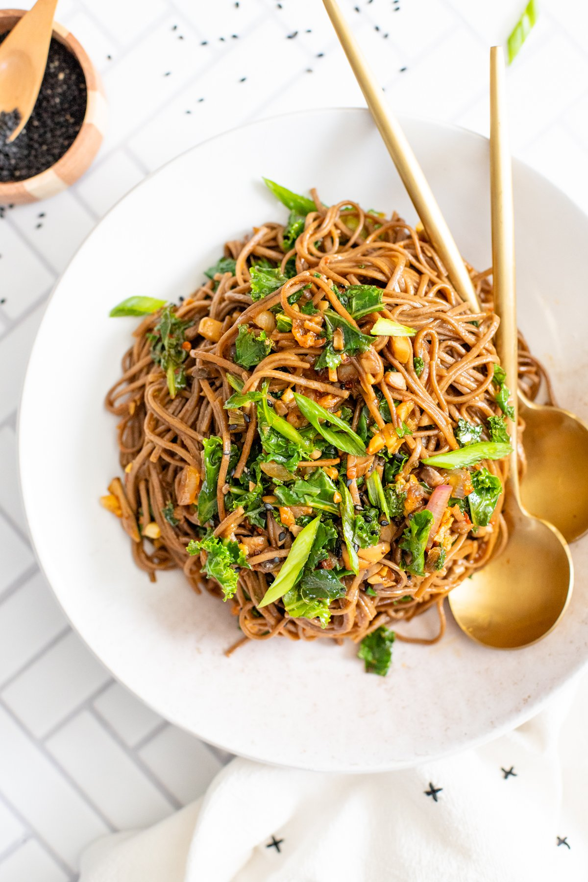 These Mushroom & Kale Soba Noodles are the perfect quick vegan dinner. The mushrooms are pan fried and tossed with kale, sauce & noodles   ThisSavoryVegan.com #thissavoryvegan #quickvegandinner #vegannoodles