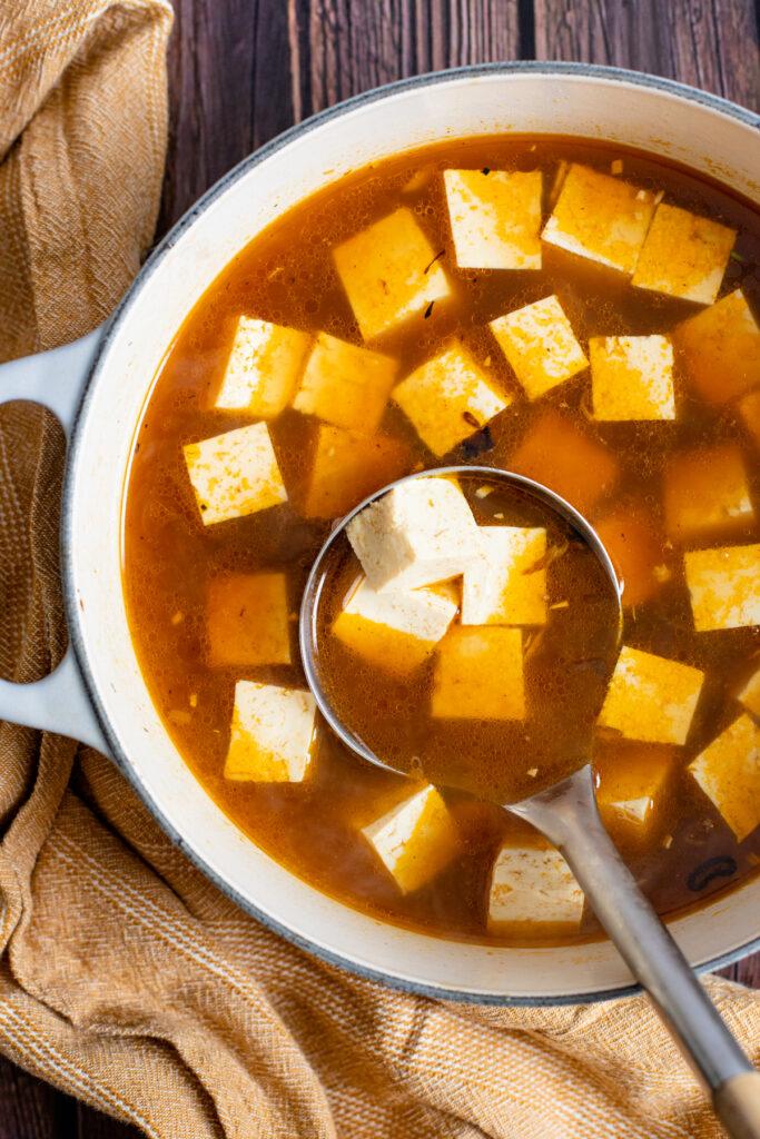 This Simple Vegan Ramen is comfort in a bowl. Crispy mushrooms & shallots, tofu, bok choy and a tasty vegan broth! A must make!   ThisSavoryVegan.com #thissavoryvegan #veganramen #fallrecipes