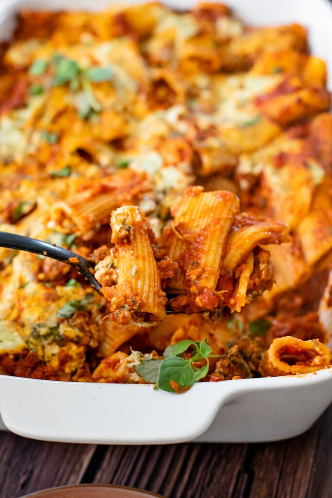 Comfort food in a casserole dish - this Vegan Baked Rigatoni Bolognese is the perfect family dinner! A simple and flavorful vegan dinner idea   ThisSavoryVegan.com #thissavoryvegan #veganpasta #pastabake