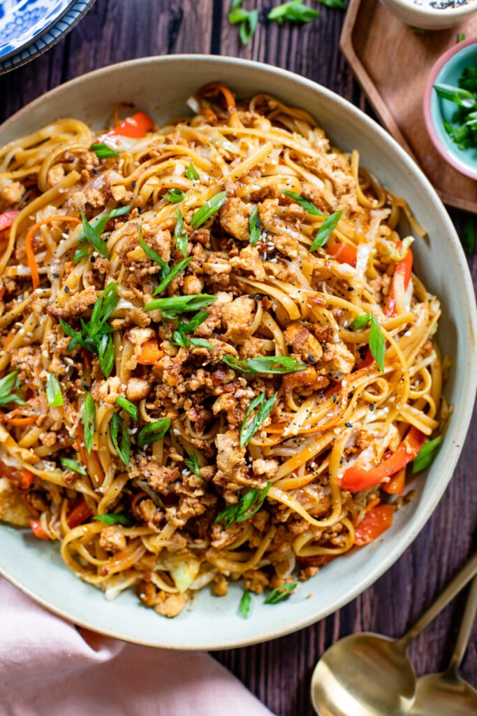 Ready in 30 minutes, filled with veggies and totally tasty. These Simple Hoisin Tofu Noodles are a quick and easy vegan dinner idea   ThisSavoryVegan.com #vegannoodles #veganstirfry #vegandinneridea
